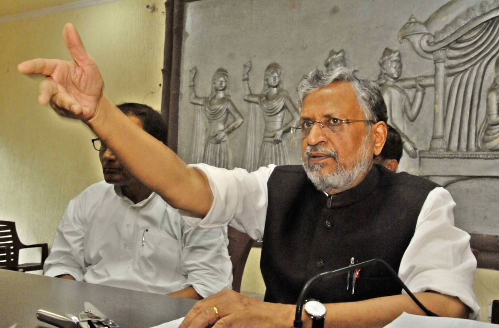 BJP leader Sushil Kumar Modi addresses a press conference in Patna on July 4, 2017. - Sushil Kumar Modi