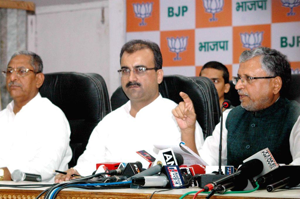 BJP leader Sushil Kumar Modi addressing the media at BJP office in Patna on Sept. 6, 2014.