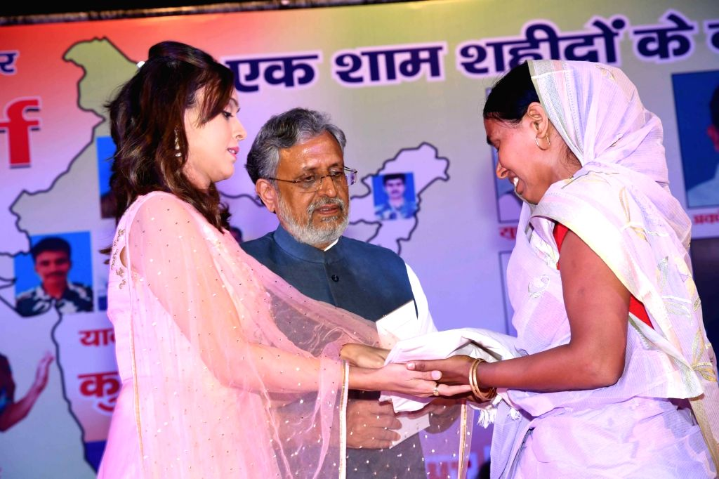 BJP leader Sushil Kumar Modi and actress Hrishita Bhatt during a programme organised to felicitate family members of April 24 Sukma Attack martyrs; in Patna on June 27, 2017. In the deadliest ... - Hrishita Bhatt and Sushil Kumar Modi