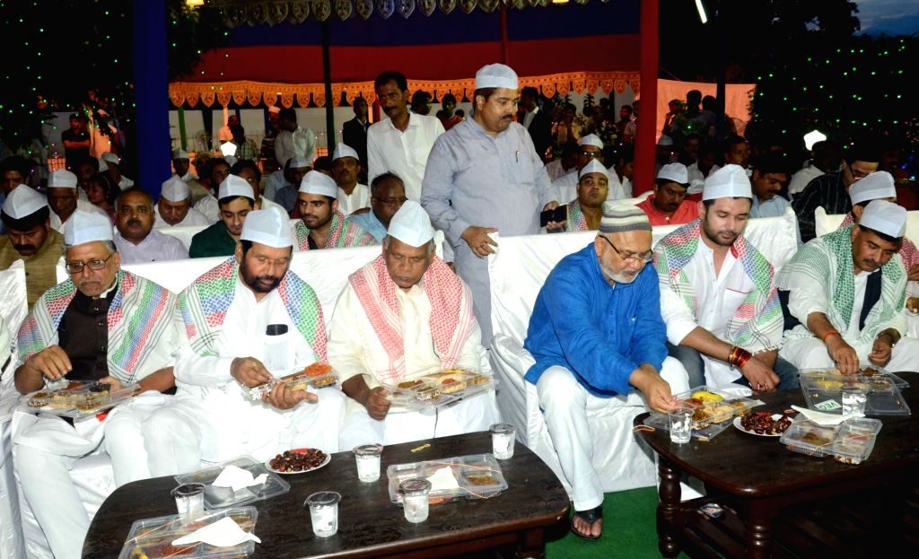 BJP leader Sushil Kumar Modi and HAM leader Jitan Ram Manjhi during an iftaar party hosted by LJP chief and Union Minister for Consumer Affairs, Food and Public Distribution Ramvilas Paswan in ... - Sushil Kumar Modi