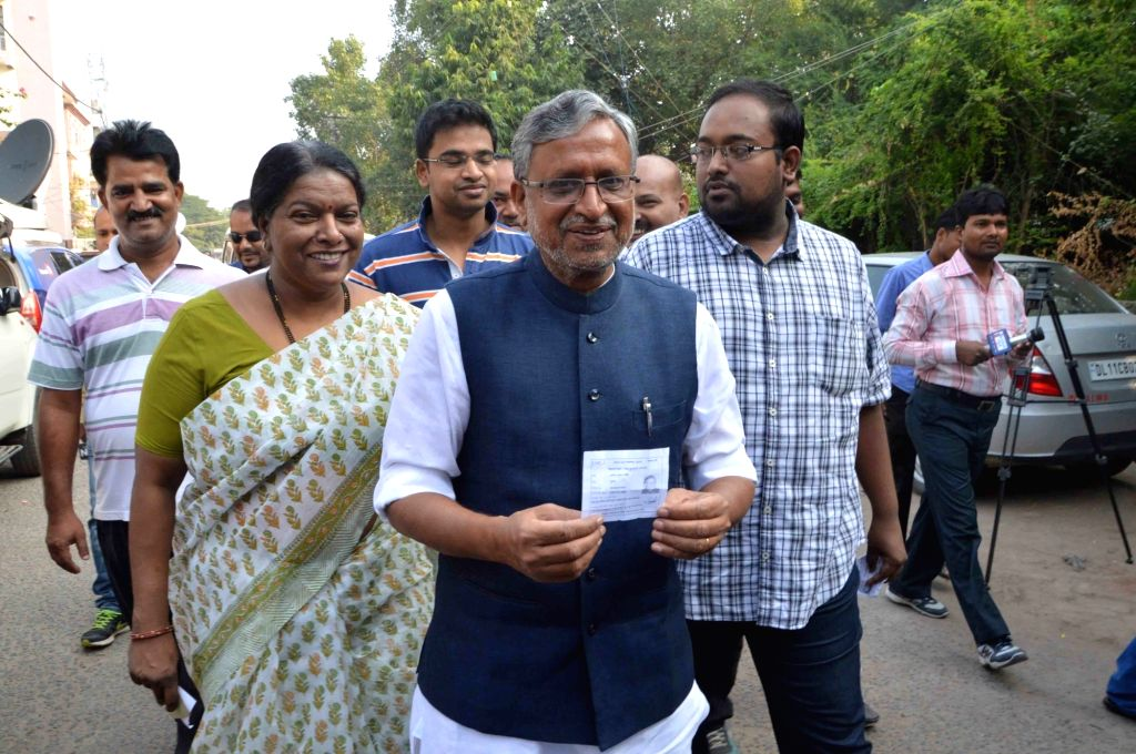 BJP leader Sushil Kumar Modi arrive with his family to cast their vote during the third phase of Bihar assembly polls in Patna on Oct 28, 2015.