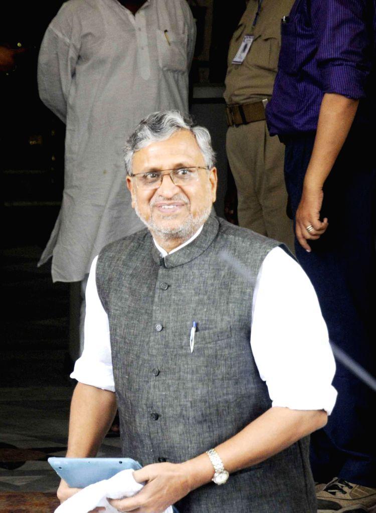 BJP leader Sushil Kumar Modi arrives to attend the Monsoon Session of Bihar Legislative Council in Patna on July 1, 2014.