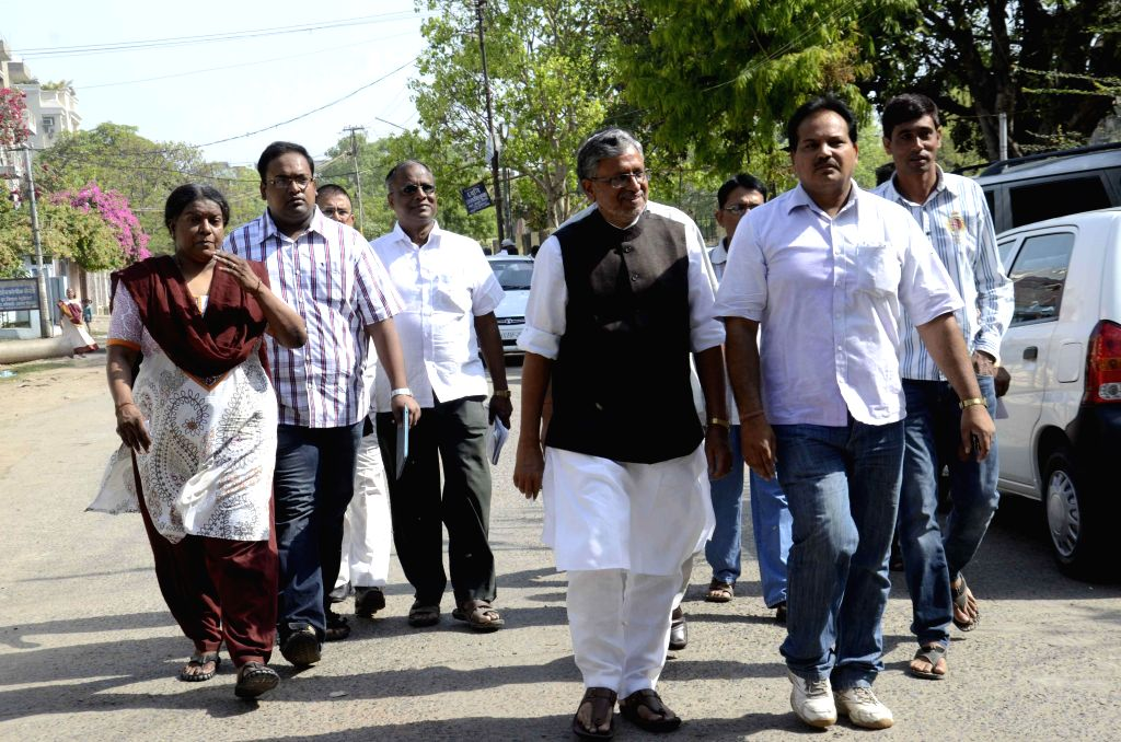 BJP leader Sushil Kumar Modi arrives to cast his vote during the fifth phase of 2014 Lok Sabha Polls in Patna on April 17, 2014.