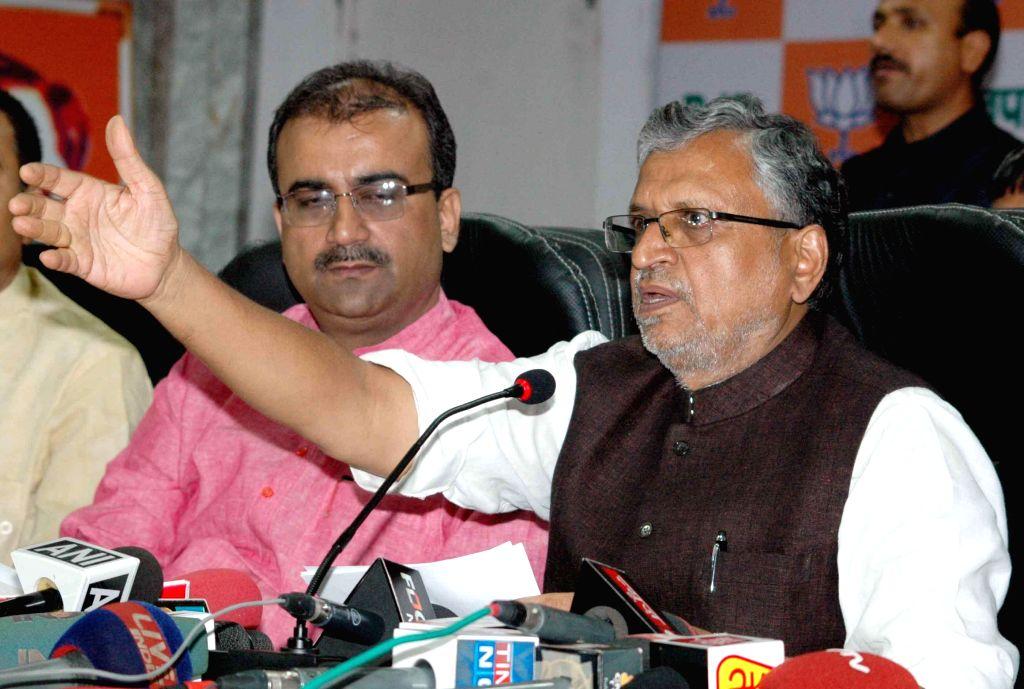 BJP leader Sushil Kumar Modi during a press conference in Patna on Sept 11, 2014. - Sushil Kumar Modi