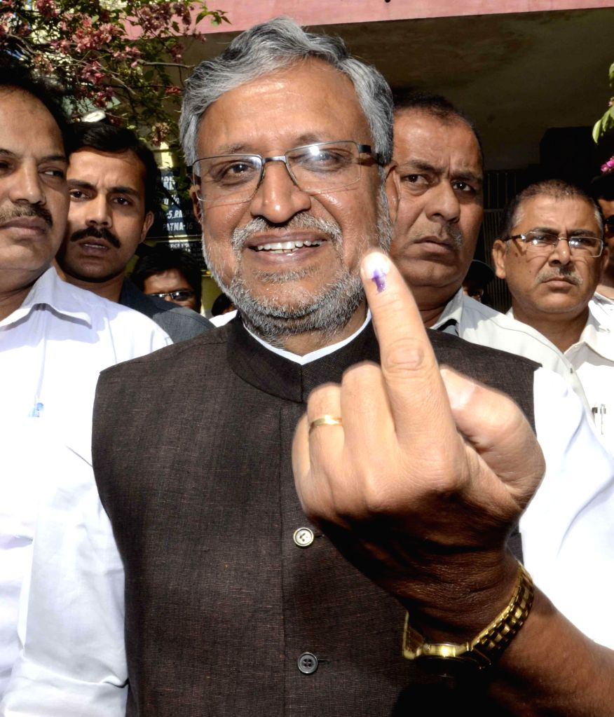 BJP leader Sushil Kumar Modi shows his fore finger marked with phosphoric ink after casting his vote during the fifth phase of 2014 Lok Sabha Polls in Patna on April 17, 2014.