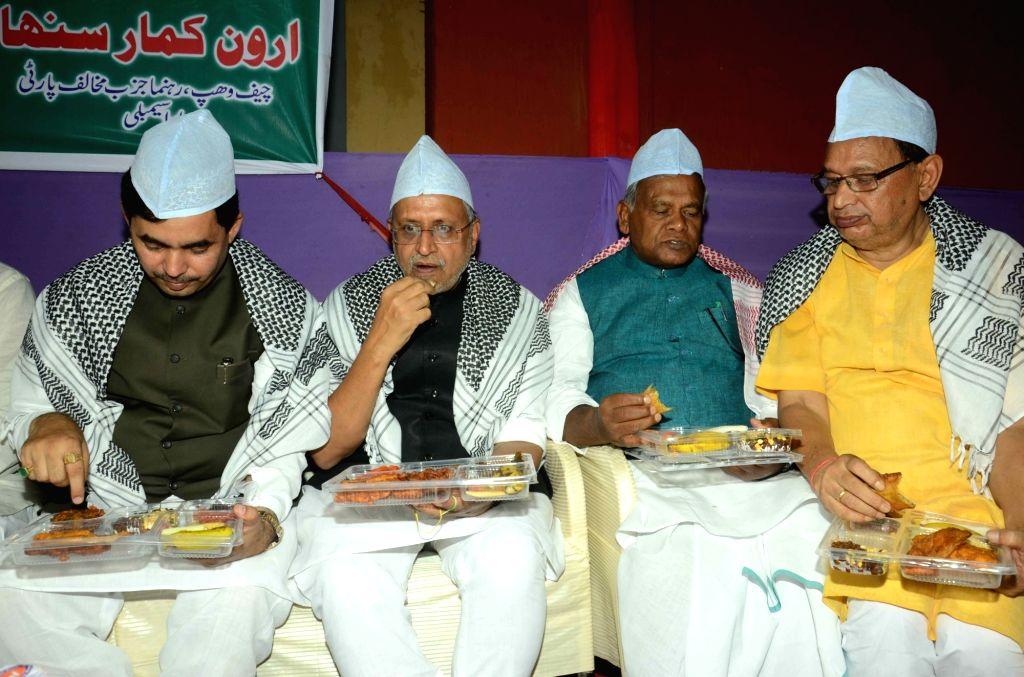 BJP leader Sushil Kumar Modi, Syed Shahnawaz Hussain and Jitan Ram Manjhi during an iftaar party in Patna on June 30, 2016. - Sushil Kumar Modi