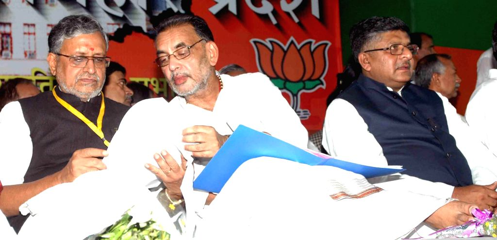 BJP leader Sushil Kumar Modi, Union Minister for Agriculture Radha Mohan Singh and Union Minister for Communications and Information Technology, and Law and Justice, Ravi Shankar Prasad during a BJP . - Sushil Kumar Modi and Radha Mohan Singh