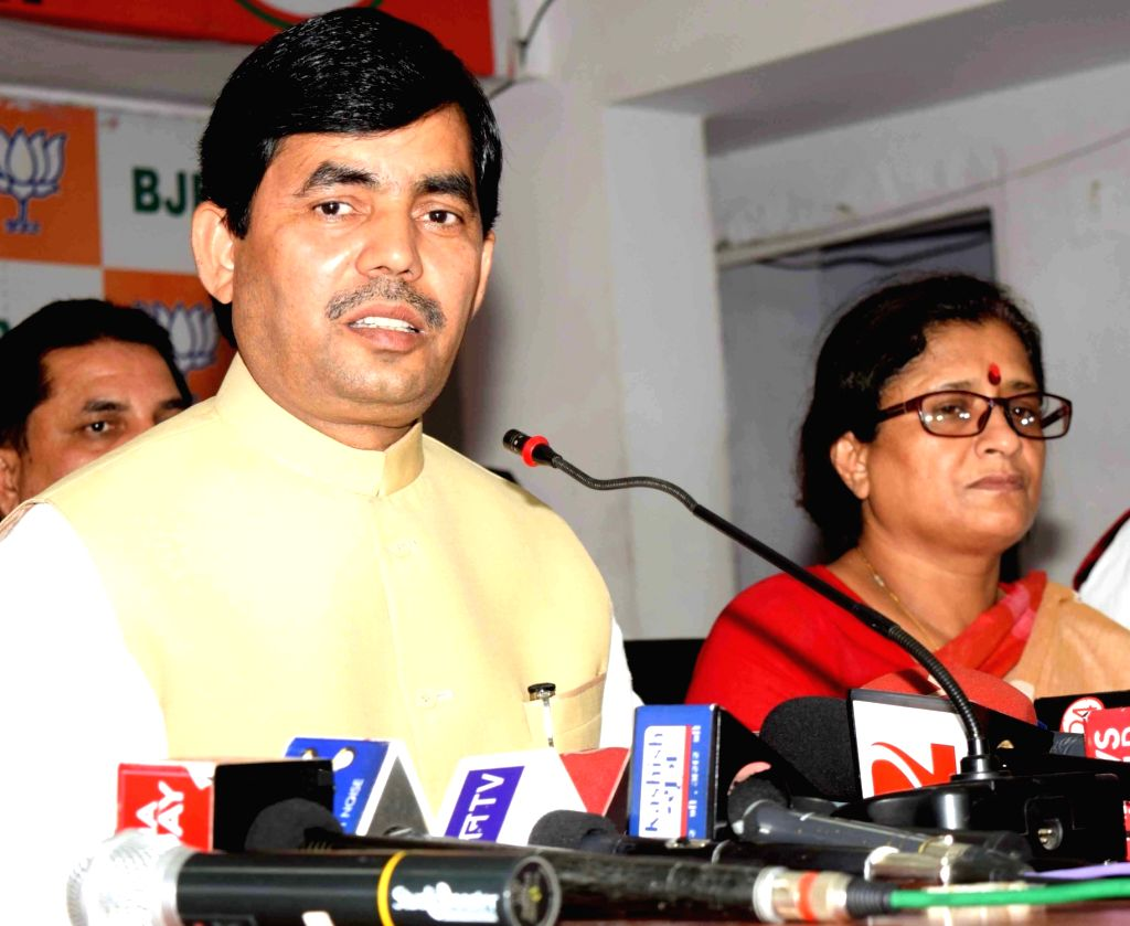 BJP leader Syed Shahnawaz Hussain addresses a press conference in Patna, on May 16, 2016.