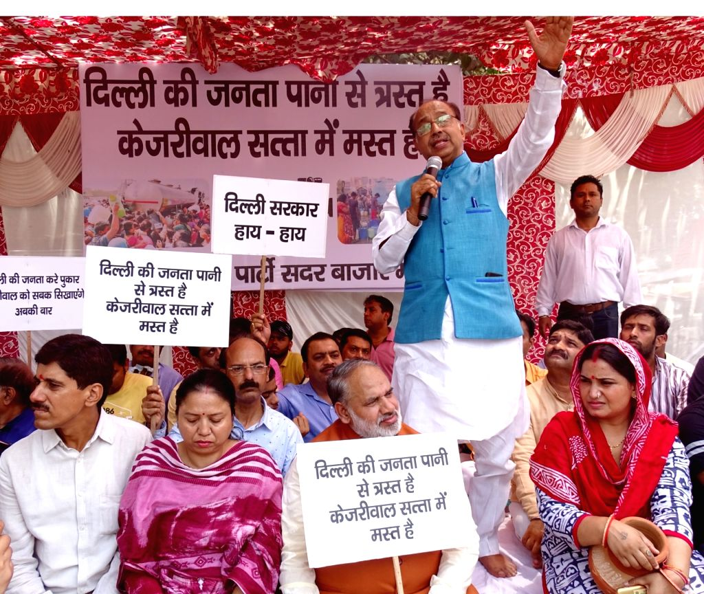 BJP leader Vijay Goel addresses a gathering of party workers during the party's demonstration against the Delhi Government over water crisis in the Capital, in New Delhi on June 4, 2019.