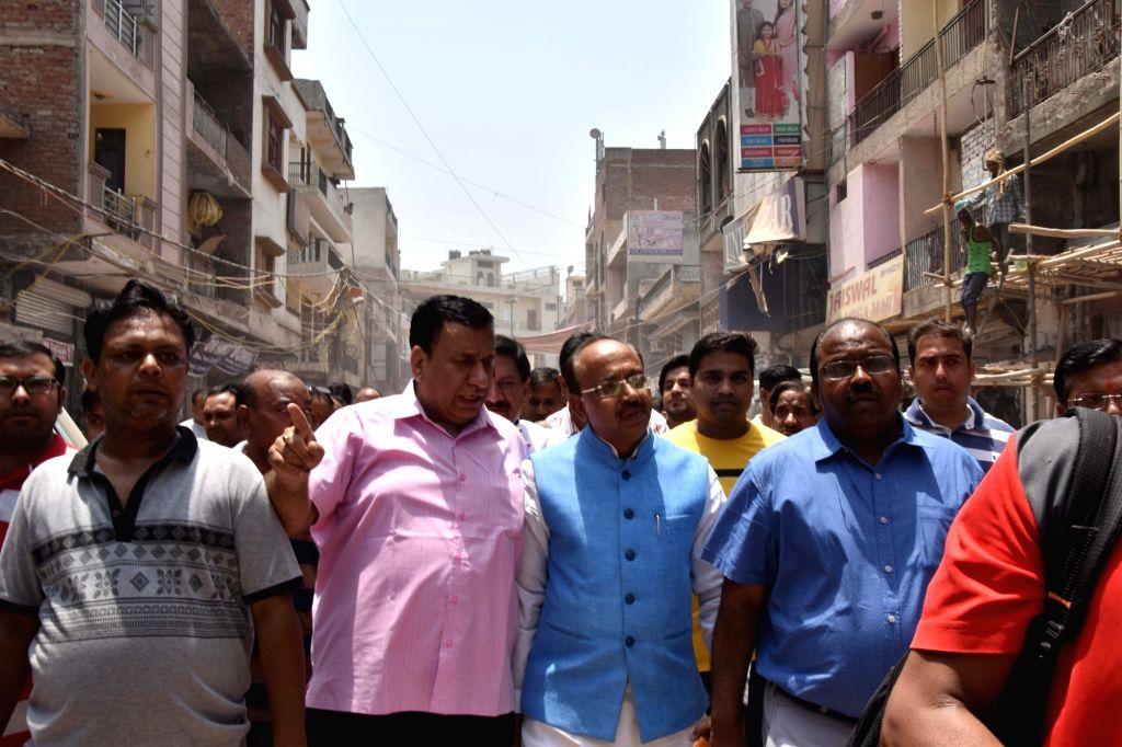 BJP leader Vijay Goel interacts with traders after MCD razed illegal structures at Vijay Chowk in New Delhi's Laxmi Nagar, on May 22, 2018.
