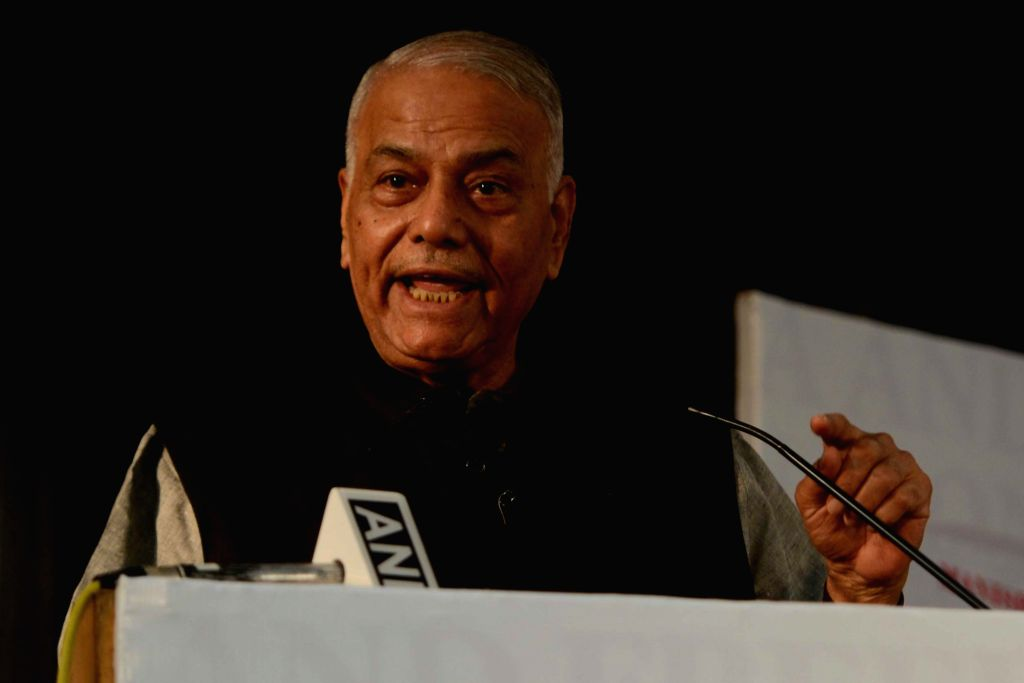 "BJP leader Yashwant Sinha addresses at the release of Congress leader Manish Tewari's book ""Tidings of Troubled Times"" in New Delhi, on Oct 5, 2017. - Yashwant Sinha"
