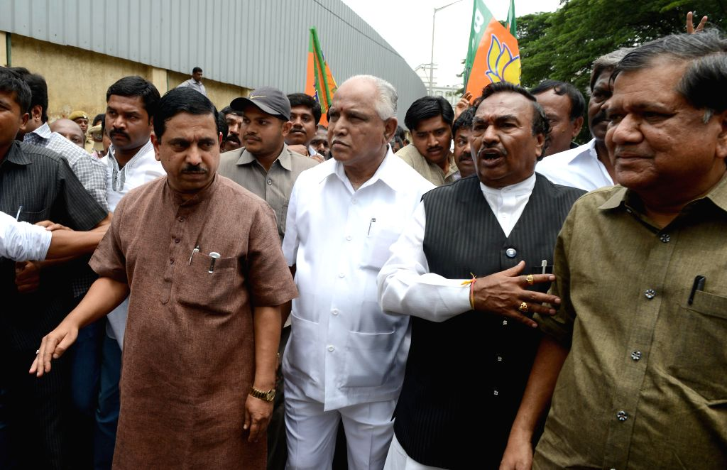 BJP leaders B S Yeddyurappa, K. S. Eshwarappa, Pralhad Joshi and others demonstrate against Siddaramaiah led Karnataka Government for its failure to curb crime against women in the state, in ... - Pralhad Joshi