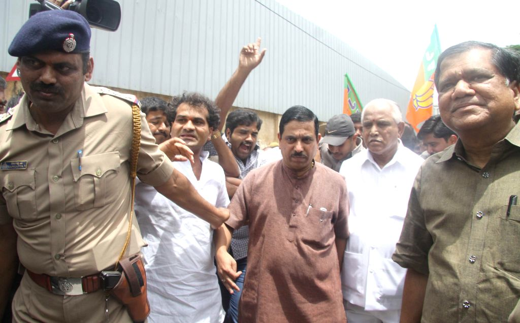 BJP leaders B S Yeddyurappa, K. S. Eshwarappa, Pralhad Joshi and others being arrested by police as they were demonstrating against Siddaramaiah led Karnataka Government for its failure to curb crime - Pralhad Joshi