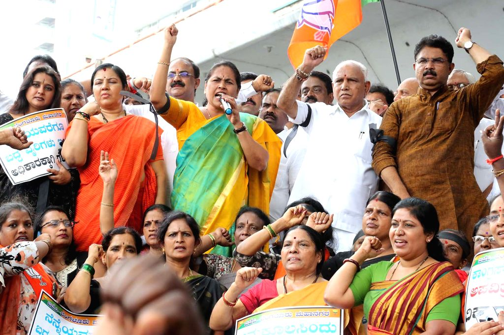 BJP leaders B S Yeddyurappa, Shobha Karandlaje and other party leaders stage a demonstration against the the alliance of JD-S and Congress, in Bengaluru on May 23, 2018.