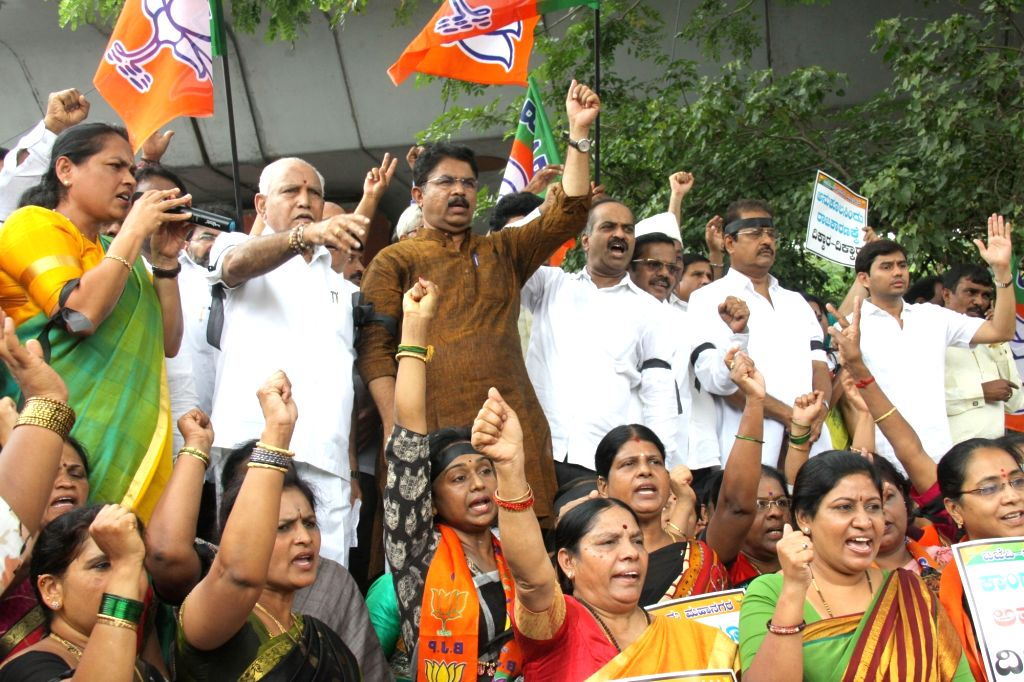 BJP leaders B S Yeddyurappa, Shobha Karandlaje, P C Mohan and other party leaders stage a demonstration against the the alliance of JD-S and Congress, in Bengaluru on May 23, 2018.