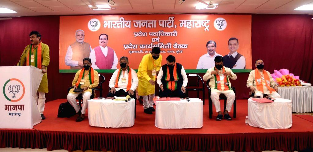 BJP leaders Chandrakant Patil, Devendra Fadnavis, Vinay Puranik, Sunil Devdhar, Pravin Darekar, Pritam Munde, Raksha Khadse and other leaders during the party's State Executive virtual ... - Chandrakant Patil