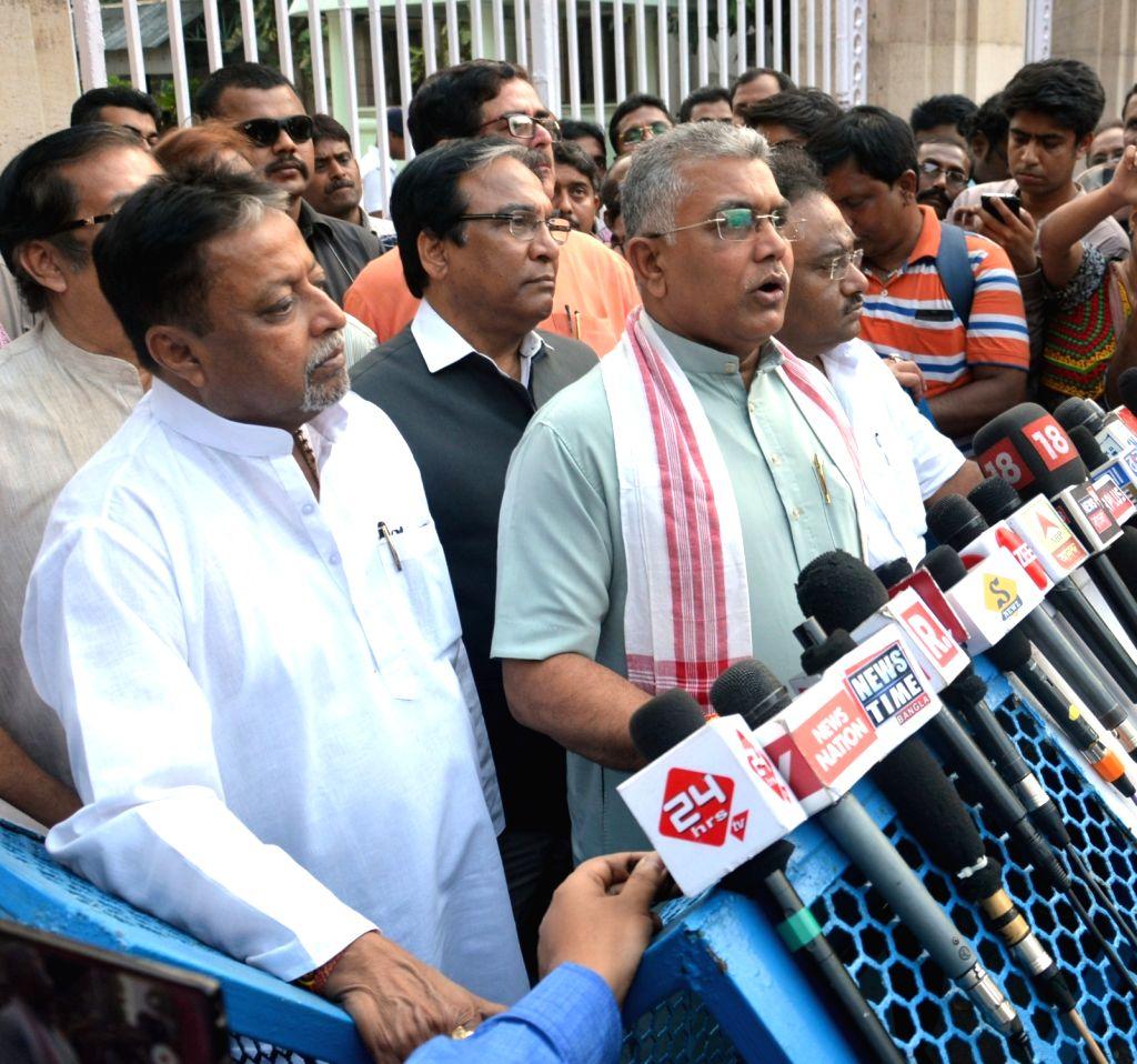 BJP leaders Dilip Ghosh, Mukul Roy and Jay Prakash Majumdar talk to the press after meeting West Bengal Governor Keshari Nath Tripathi at Raj Bhawan in Kolkata on April 3, 2018. - Dilip Ghosh, Mukul Roy and Keshari Nath Tripathi
