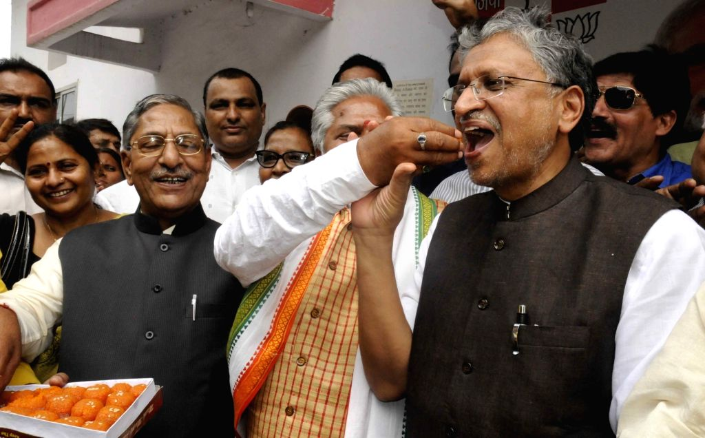 BJP leaders including Sushil Kumar Modi celebrate party's performance in the recently concluded 2016 Assam assembly polls; in Patna, on May 19, 2016. - Sushil Kumar Modi