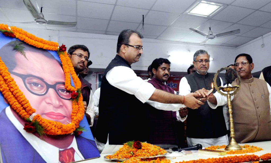 BJP leaders including Sushil Kumar Modi pay tribute to B R Ambedkar on his death anniversary in Patna on Dec. 6, 2013. - Sushil Kumar Modi