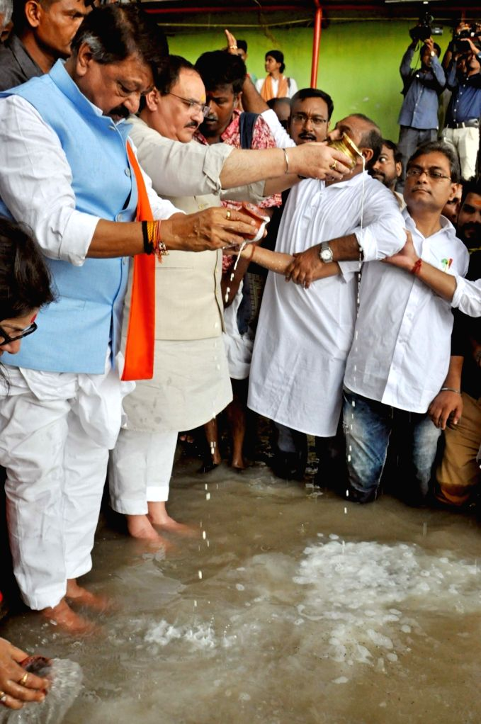 BJP leaders J.P. Nadda and Kailash Vijayvargiya perform rituals as he offers 'Tarpan' to the souls of deceased party workers who had lost their lives in the political violence that had ...