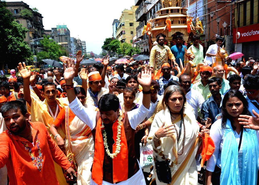 BJP leaders Kailash Vijayvargiya and Roopa Ganguly during a Rath Yatra in Kolkata on June 25, 2017.
