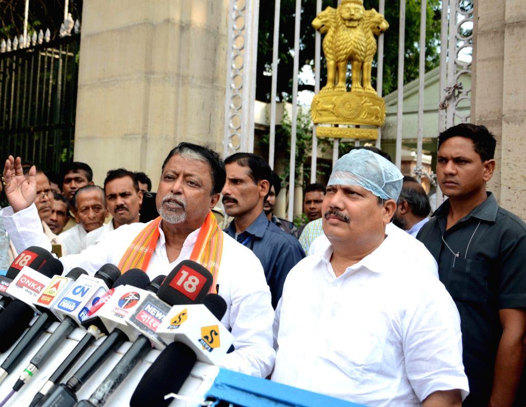 BJP leaders Mukul Roy and Arjun Singh talk to media persons after meeting West Bengal Governor Jagdeep Dhankhar, at Raj Bhavan in Kolkata on Sep 20, 2019. - Mukul Roy and Arjun Singh