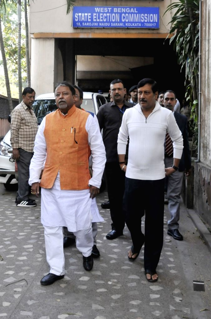 BJP leaders Mukul Roy and Sabyasachi Dutta come out after meeting West Bengal Chief Electoral Officer (CEO), in Kolkata on Jan 24, 2020. - Mukul Roy