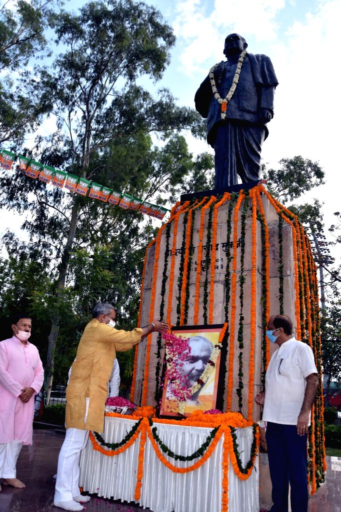 BJP leaders pay tributes to Shyama Prasad Mukherjee on his death anniversary, in New Delhi on June 23, 2020. - Shyama Prasad Mukherjee