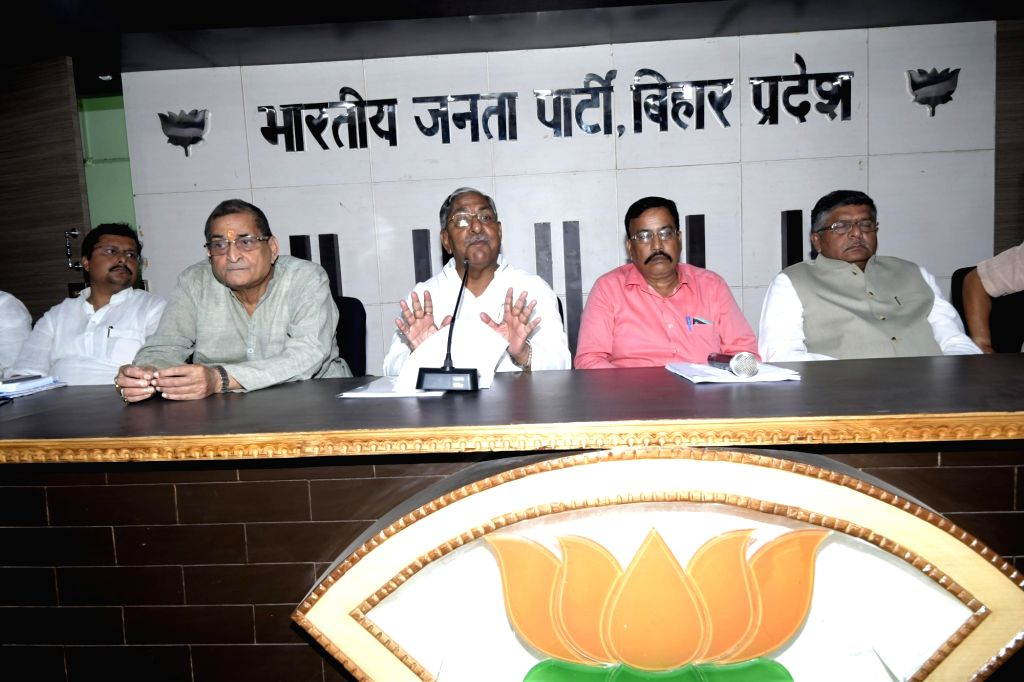 BJP leaders Ravindra Kishore Sinha and Nand Kishore Yadav during a party meeting, in Patna on Sept 15, 2018. - Ravindra Kishore Sinha and Nand Kishore Yadav