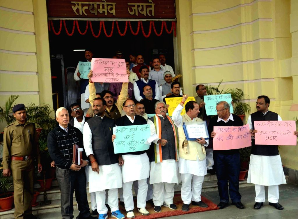 BJP leaders stage a demonstration against black money outside Bihar Assembly in Patna on Nov 28, 2016.