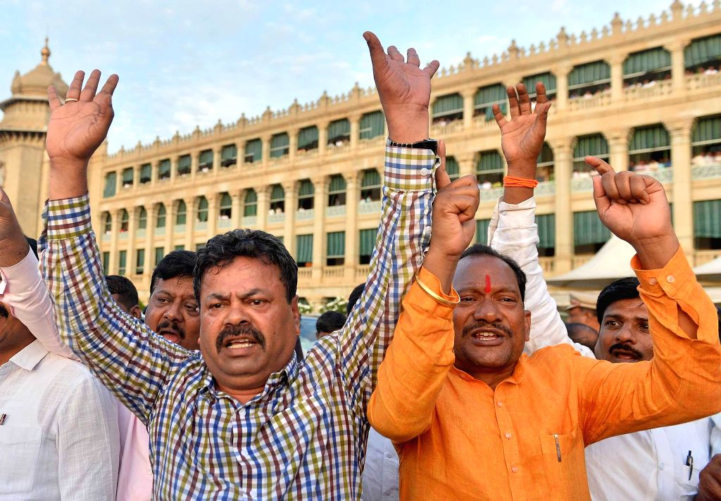 BJP leaders stage a protest in front of Karnataka Minister K J George's chamber in at Vidhana Soudha, in Bengaluru on July 10, 2019. This comes after Chikballapur MLA K. Sudhakar and Hoskote MLA and Housing Minister M.T.B. Nagaraj handed over their r - K J Georg and R. Ramesh Kumar