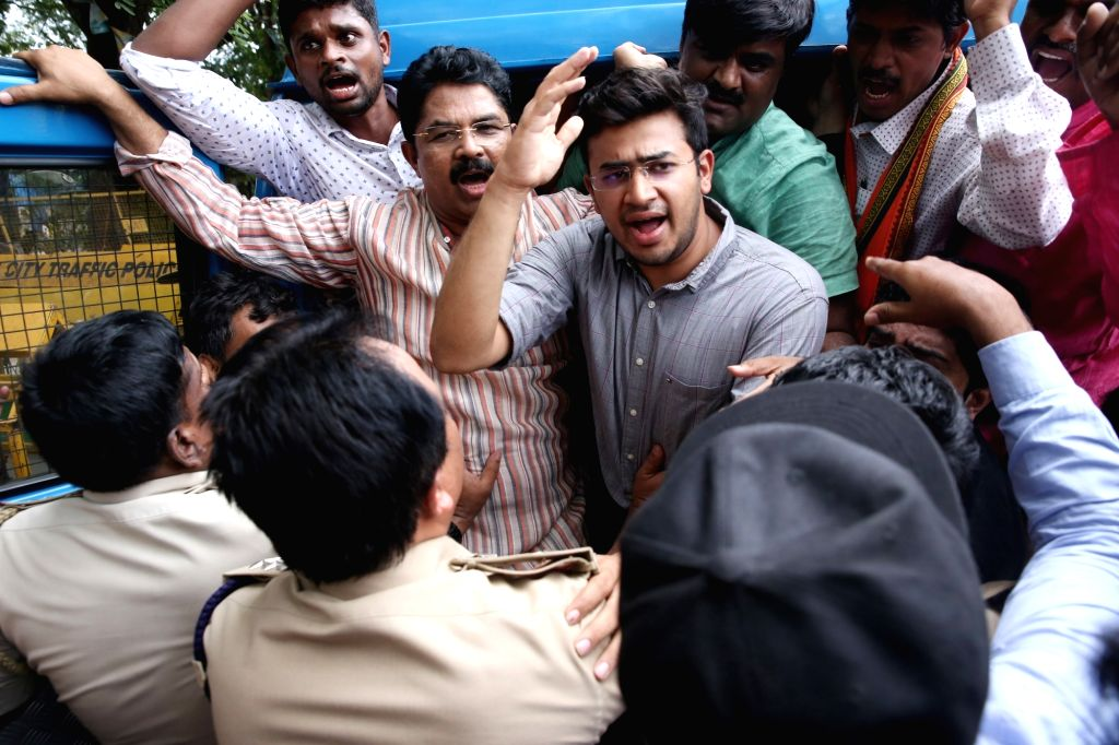 BJP leaders Tejasvi Surya and R. Ashoka being taken into custody during their demonstration against the Karnataka Government for allotment of land to JSW Steel to set up a facility in ...