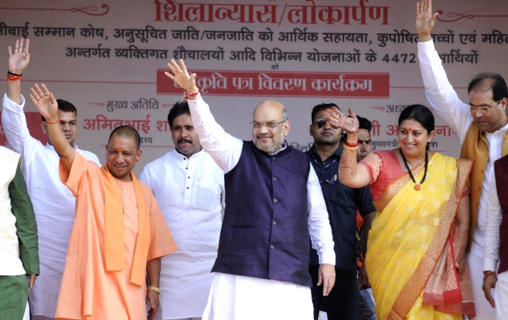 BJP leaders Yogi Adityanath, Amit Shah and Smriti Irani during a BJP rally in Amethi, Uttar Pradesh on Oct 10, 2017. - Amit Shah and Smriti Irani
