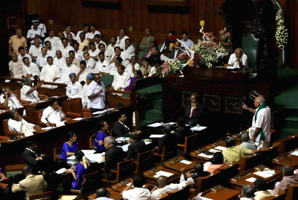 BJP legislator and Keader of opposition in the Karnataka Assembly B. S. Yeddyurappa addresses in the assembly in Bengaluru, on May 25, 2018. BJP members on Friday walked out of the ... - H.