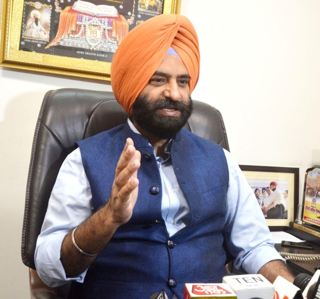 BJP legislator from Rajouri Garden Manjinder Singh Sirsa addresses a press conference in New Delhi on May 20, 2017.