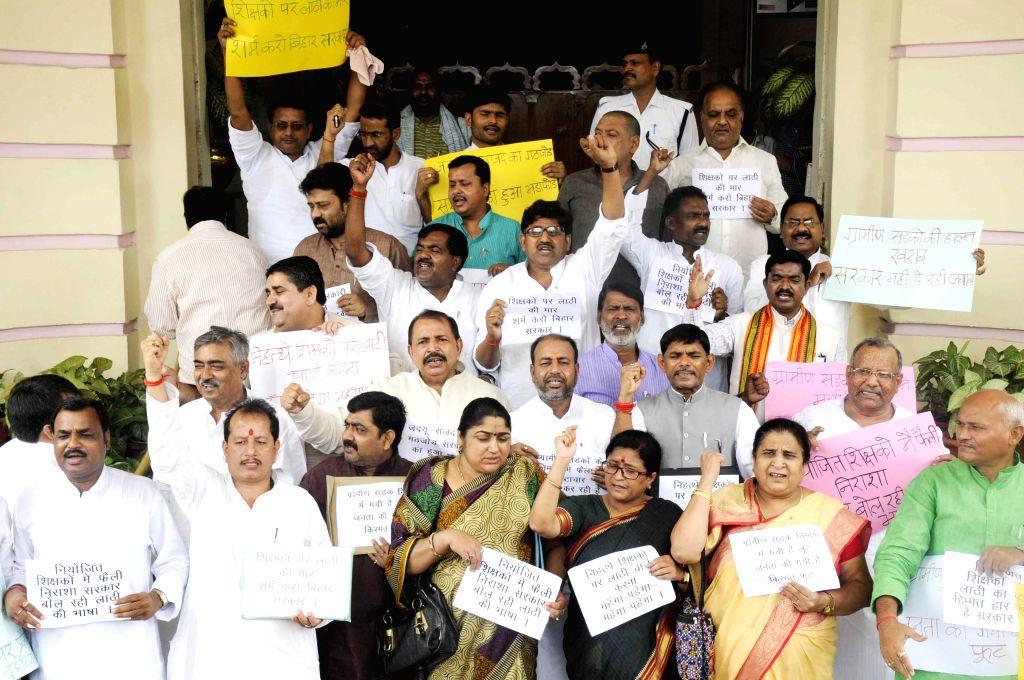 BJP legislators demonstrate against lathicharge on teachers at Bihar Assembly on July 16, 2014.