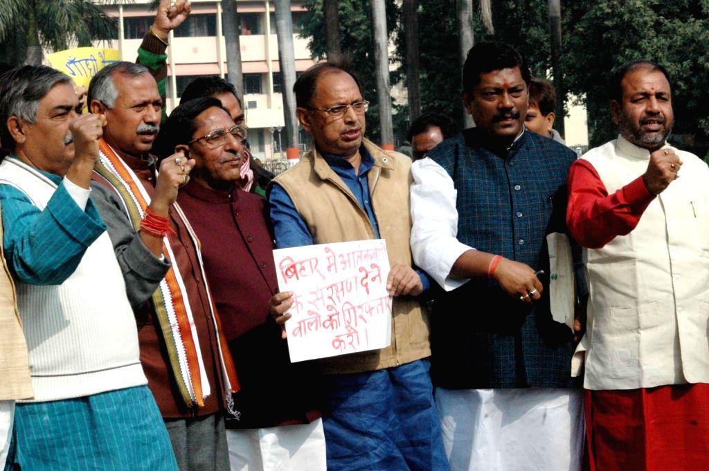 BJP legislators demonstrate in Bihar Legislative Assembly premises in Patna on Dec.13, 2013.