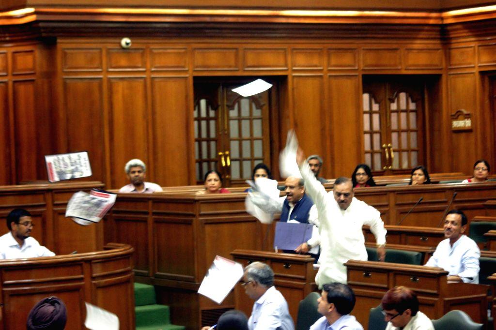 BJP legislators interupt the proceedings of the Delhi Legislative Assembly on the Day 1 of the monsoon session in New Delhi on Aug 3, 2015.