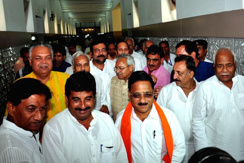 BJP legislators leaves Uttar Pradesh assembly after demonstration during the Monsoon session in Lucknow, on Aug 17, 2015.