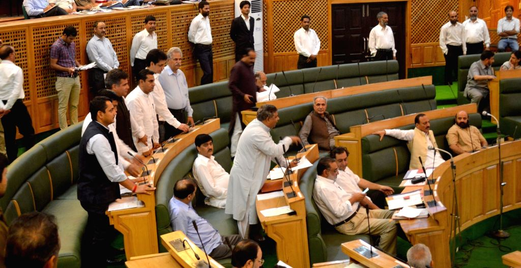 BJP legislators stage a demonstration against attack on CRPF convoy in Pampore , in Jammu and Kashmir Assembly on June 27, 2016.