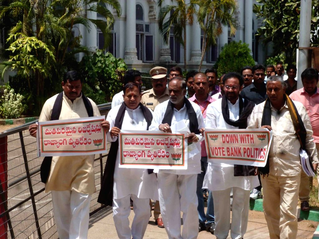 BJP legislators stage a demonstration against the draft legislation that seeks to increase quota for the Muslims to 12 per cent in Hyderabad on April 16, 2017. The bill also has provisions ...