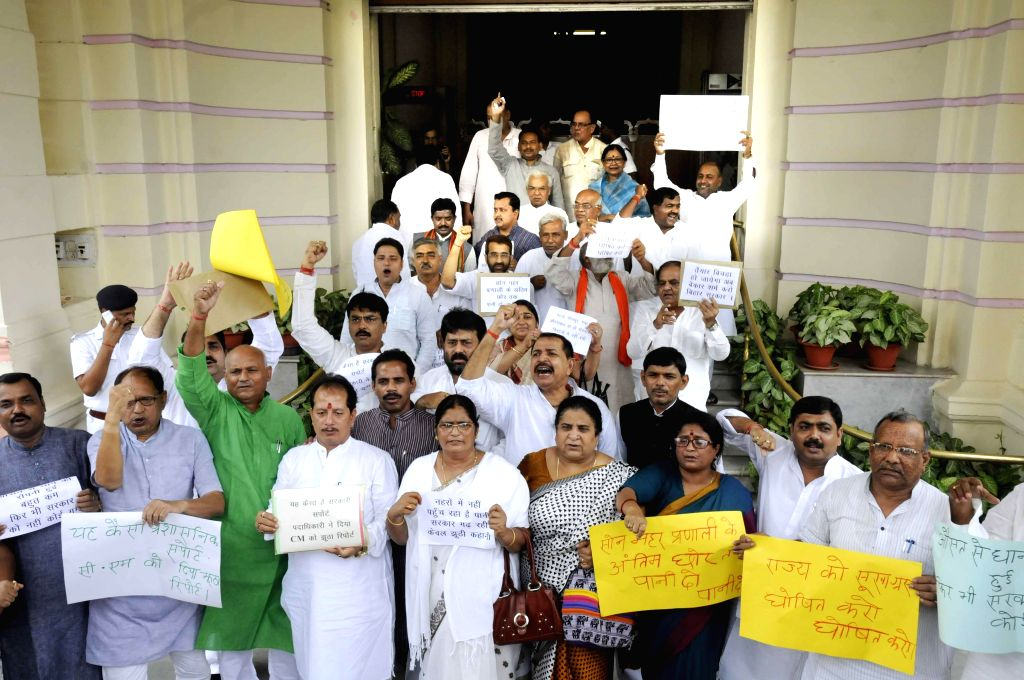 BJP legislators stage a demonstration at Bihar Legislative Assembly premises in Patna on July 23, 2014.