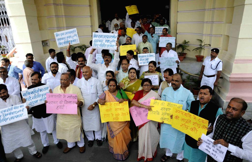 BJP legislators stage a demonstration at Bihar assembly in Patna, on Aug 5, 2015.