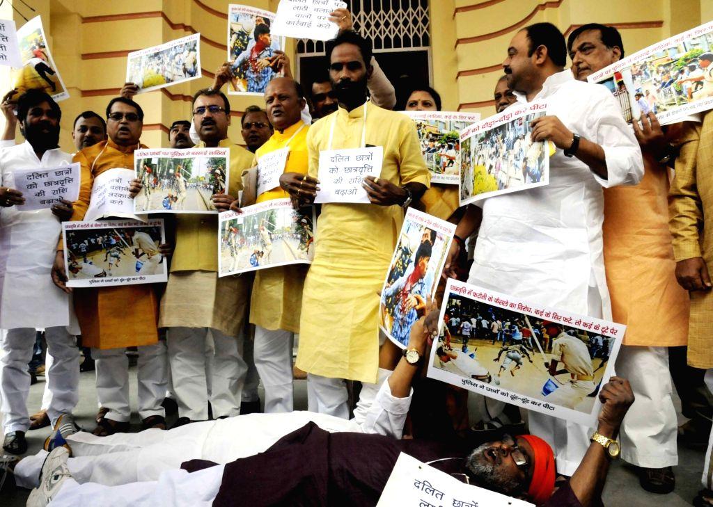 BJP legislators stage a demonstration at the Bihar Assembly in Patna on Aug 4, 2016.