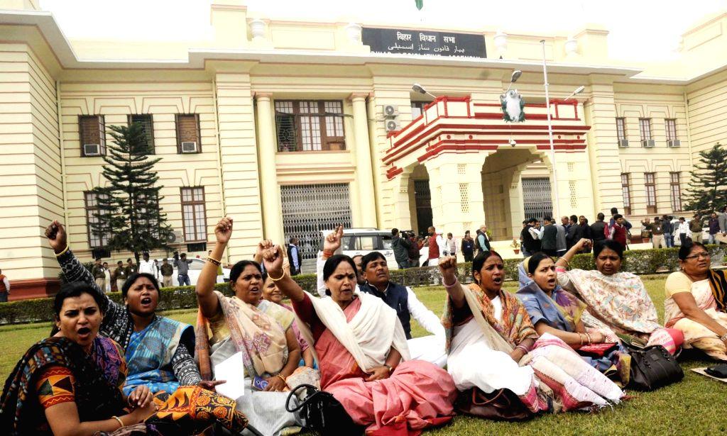 BJP legislators stage a demonstration outside Bihar Assembly in Patna on Nov 29, 2016.
