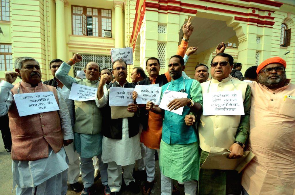 BJP legislators stage a demonstration outside Bihar Assembly in Patna on Nov 30, 2016.