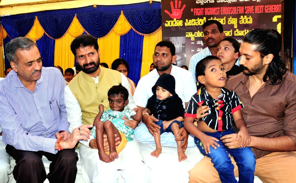 BJP legislators Suresh Kumar, CT Ravi and actor Chetan Kumar participate during `Fight against Endosulfan Save Next Generation`- an awareness campaign, in Bengaluru, on Nov 18, 2015. - Chetan Kumar and Suresh Kumar