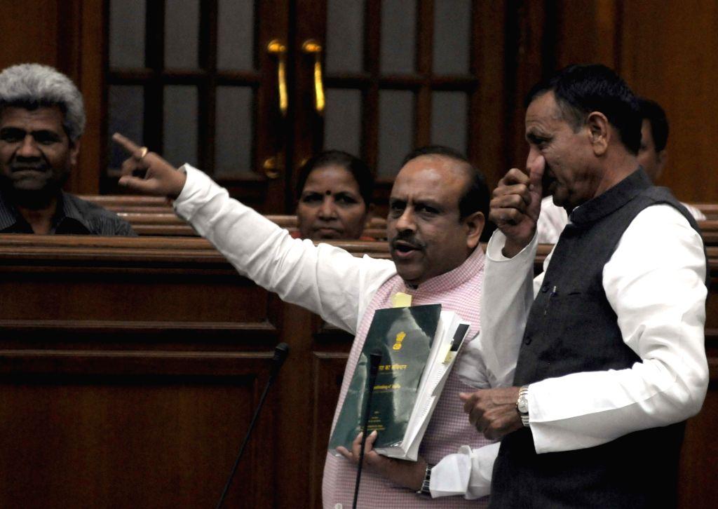 BJP legislators Vijender Gupta and Jagdish Pradhan during the winter session of Delhi Assembly, in New Delhi on Nov 27, 2015. - Vijender Gupta