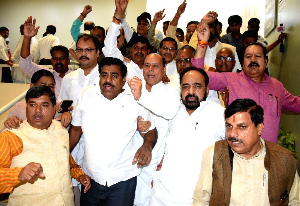 BJP legislators walk out of Madhya Pradesh Assembly in Bhopal on July 18, 2019.