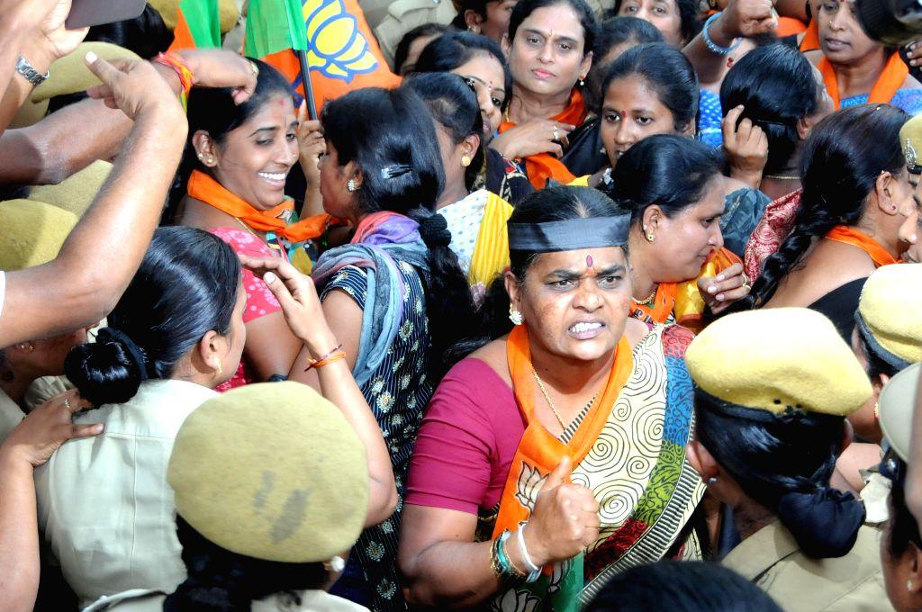 BJP Mahila Morcha activists stage a demonstration against Karnataka Government in Bengaluru, on Nov 5, 2014.